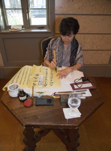 Chinese Calligraphy demonstration by Sunny Tsai, the Cultural and Educational Scholarship Foundation of Chinese Women's Club of Greater Miami Chairwoman