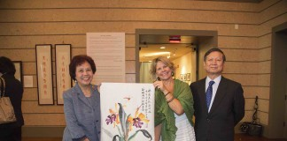 Ms Panxiong Hua presented a painting to Christine Rupp-Coral Gables Museum curator