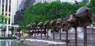 """Ai Weiwei, """"Circle of Animals/Zodiac Heads: Bronze,"""" 2010. Bronze. Dimensions variable, approximate sizes: Snake 118"""" high x 53"""" wide x 63"""" deep Ox 128"""" high x 62"""" wide x 63"""" deep Dragon 134"""" high x 66"""" wide x 77"""" deep Dog 119"""" high x 53"""" wide x 68"""" deep Monkey 119"""" high x 53"""" wide x 56"""" deep Ram 120"""" high x 60"""" wide x 62"""" deep Tiger 129"""" high x 53"""" wide x 62"""" deep Horse 119"""" high x 53"""" wide x 61"""" deep Rat 119"""" high x 53"""" wide x 63"""" deep Rabbit 129"""" high x 53"""" wide x 63"""" deep Pig 119"""" high x 53"""" wide x 67"""" deep Rooster 144"""" high x 53"""" wide x 55"""" deep Private Collection. Image courtesy of Ai Weiwei."""