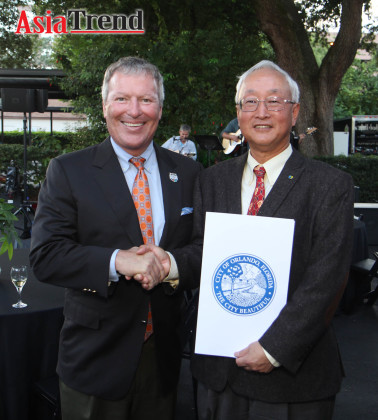 City of Orlando Mayor Buddy Dyer and C.T. Hsu