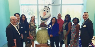 Asian American Chamber members tour the Nemours Children's Hospital, stopping at a play zone for patients and families. Matt Thursam, Jackson Young, Mitzi Archer, Vanessa Rivera, Gail Rayos, Robert Lee, Dahlia Hayles, Raqcuel Hayles, Ernie Plaza